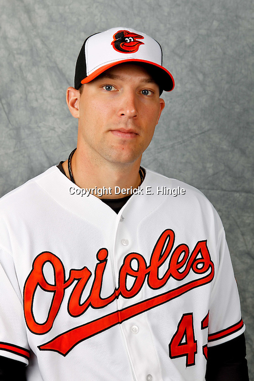 March 1, 2012; Sarasota, FL, USA; Baltimore Orioles relief pitcher Jim Johnson (43) poses for a portrait during photo day at the spring training headquarters.  Mandatory Credit: Derick E. Hingle-US PRESSWIRE