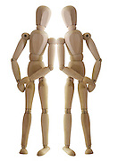 Posed artist manikin on white background supporting each other