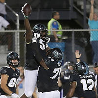ORLANDO, FL - OCTOBER 14: Jamiyus Pittman #5 of the UCF Knights celebrates a touchdown with Chavis Dickey #79 of the UCF Knights and Taj McGowan #12 of the UCF Knights during a NCAA football game between the East Carolina Pirates and the UCF Knights at Spectrum Stadium on October 14, 2017 in Orlando, Florida. (Photo by Alex Menendez/Getty Images)