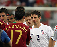 Photo: Chris Ratcliffe.<br /> England v Portugal. Quarter Finals, FIFA World Cup 2006. 01/07/2006.<br /> Gary Neville of England shakes hands with Ronaldo of Portugal.