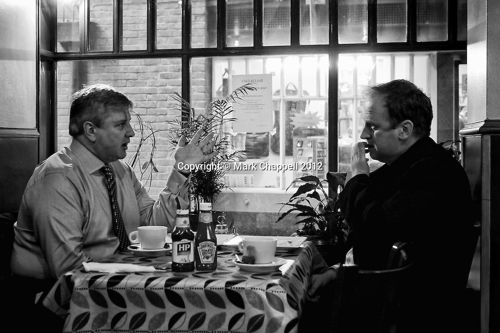 LONDON, UNITED KINGDOM. FEBRUARY 07 2012. Neil Turner (L) and Eddie Mulholland (R), Vice-Chairmen of the BPPA, meet over breakfast, prior to the British Press Photographers' Association's submission to the Leveson Enquiry into the Culture, Practice and Ethics of the Press. © Mark Chappell 2012. All Rights Reserved. See instructions.