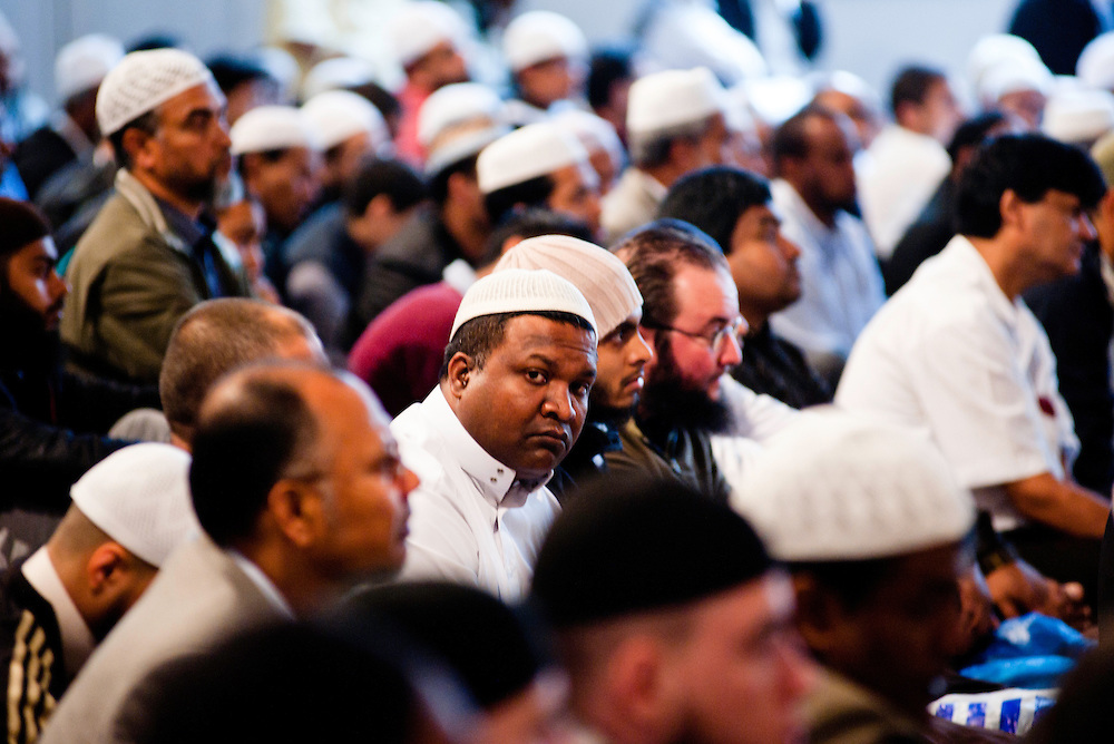 London, UK - 20 July 2012: One of the 6500 Muslim believers celebrates the first day of Ramadan in the East London Mosque, the largest in Britain.