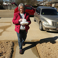 Colita Corder, a Meals on Wheels volunteer, delivers a meal to the residence Sara LaPrade at her Tupelo on Wednesday. Corder has been volunteering for Meals on Wheels for 15 years.