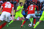 Brighton central midfielder Dale Stephens looks for an opening during the Sky Bet Championship match between Charlton Athletic and Brighton and Hove Albion at The Valley, London, England on 23 April 2016. Photo by Bennett Dean.
