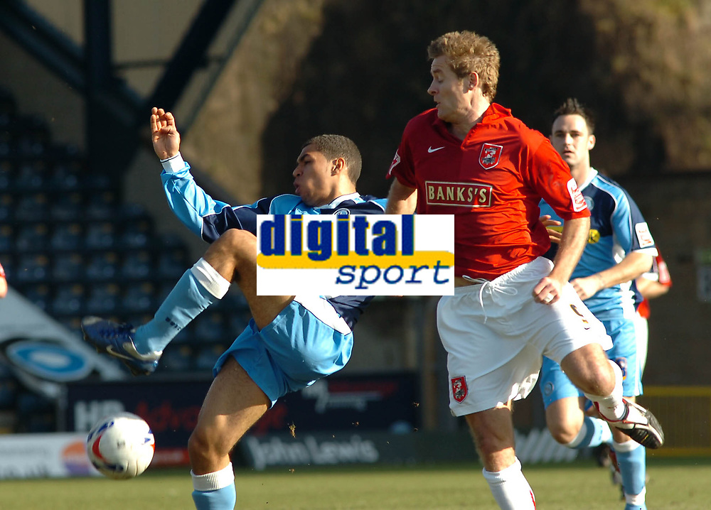 Photo: Kevin Poolman.<br />Wycombe Wanderers v Walsall. Coca Cola League 2. 17/03/2007. Scott Golbourne of Wycombe (left) clears the ahead of Martin Bulter of Walsall.