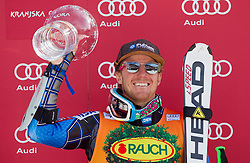 Winner LIGETY Tedof USA celebrates with a Trophy during flower ceremony after the 2nd Run of 8th Men's Giant Slalom - Pokal Vitranc 2012 of FIS Alpine Ski World Cup 2011/2012, on March 10, 2012 in Vitranc, Kranjska Gora, Slovenia.  (Photo By Vid Ponikvar / Sportida.com)
