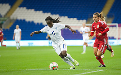 CARDIFF, WALES - Tuesday, August 21, 2014: England's Eniola Aluko in action against Wales during the FIFA Women's World Cup Canada 2015 Qualifying Group 6 match at the Cardiff City Stadium. (Pic by Ian Cook/Propaganda)