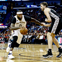 Mar 3, 2017; New Orleans, LA, USA; New Orleans Pelicans forward DeMarcus Cousins (0) drives past San Antonio Spurs center Pau Gasol (16) during the second quarter of a game at the Smoothie King Center. Mandatory Credit: Derick E. Hingle-USA TODAY Sports
