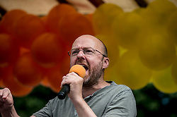 Patrick Harvie MSP speaks to the crowd before the annual Pride Edinburgh march took place from outside the Scottish Parliament.<br /> <br /> © Dave Johnston/ EEm