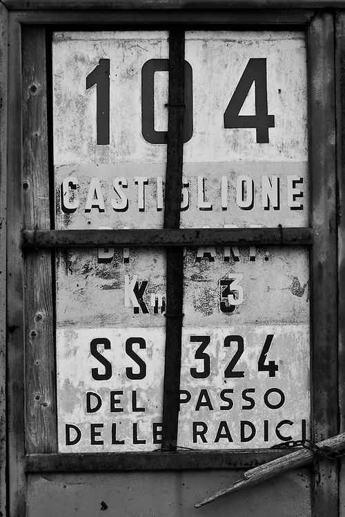 Black and white photograph of old sign <br /> in Castiglione, north Italy.