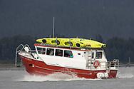 A shuttle carries kayakers to Kenai Fjords National Park near Seward, Alaska