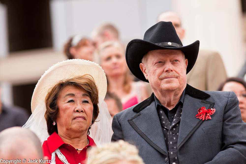 14 FEBRUARY 2012 - PHOENIX, AZ:    MIMI WONG and her fiance, RICH PARTAIN wait for their wedding to start in front of the Arizona Supreme Court. Ninetysix couples got married in a mass ceremony on the steps of the Arizona Supreme Court to mark the Valentine's Day holiday. The wedding was also an occasion to mark Arizona's centennial of statehood.    PHOTO BY JACK KURTZ