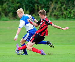 Bristol Rovers' U18s Ryan Broom is tackled - Photo mandatory by-line: Dougie Allward/JMP - Tel: Mobile: 07966 386802 17/08/2013 - SPORT - FOOTBALL - Bristol Rovers Training Ground - Friends Life Sports Ground - Bristol - Academy - Under 18s - Youth - Bristol Rovers U18s V Bournemouth U18s
