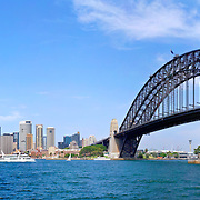 Sydney Harbour with city skyline and Sydney Harbour Bridge.