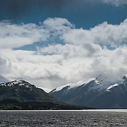 Three weeks aboard the Kong Harald. Hurtigruten, the Coastal Express. Norvegian landscape near Alesund and the Geirangerfjord. White snow on the mountains.