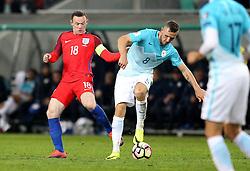 Wayne Rooney of England challenges Jasmin Kurtic of Slovenia - Mandatory by-line: Robbie Stephenson/JMP - 11/10/2016 - FOOTBALL - RSC Stozice - Ljubljana, England - Slovenia v England - World Cup European Qualifier