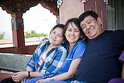 Dr Sanduk Ruit with daughters Satenla, Serabla, between surgery at Pullahari Monestry on the outskirts of Kathmandu Nepal 2014