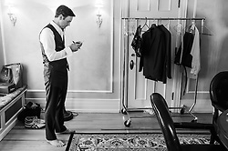 John finalizes his vows before his wedding at Grant-Humphreys Mansion on October 1, 2016, in Denver, Colorado.