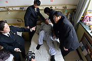 "BEIJING, CHINA - FEBRUARY 10: (CHINA OUT) <br /> <br /> A Patient Refuses To Leave Hospital Bed After Being Cured<br /> <br /> The police take a ""patient\"" away from hospital bed by force at Jingmei Group General Hospital on February 10, 2015 in Beijing, China. Mr. Chen, a farmer lived in Beijing\'s Mentougou District got tumour in his left leg in 2011 and after three months of treatment in Beijing Jingmei Group General Hospital, he had been cured and had qualified conditions to leave hospital. While Mr. Chen refused to leave his bed and claimed that the hospital should be responsible for the thrombus in legs, thus he had been fixed in hospital bed by his wife for three year even thought being advised by the hospital in many times. According to related director of Jingmei Group General Hospital, thrombus was a common phenomenon after experiencing operations or crush injury and additionally Mr. Chen had been injured in a traffic accident before which resulted in his slight thrombus disease. Without other way of sending him away, the hospital filed a lawsuit and the police forced him home. Some reports showed that the reason why Mr. Chen refused to leave was that he didn't believe the hospital's diagnosis and staying was his way to defend rights. <br /> ©Exclusivepix Media"