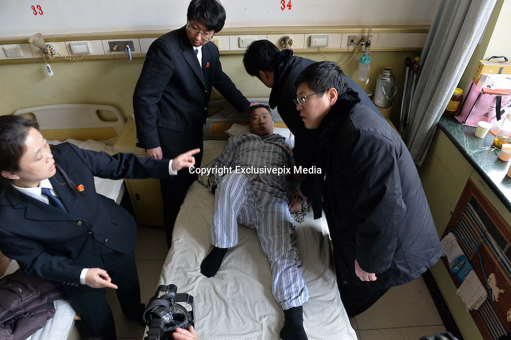 """BEIJING, CHINA - FEBRUARY 10: (CHINA OUT) <br /> <br /> A Patient Refuses To Leave Hospital Bed After Being Cured<br /> <br /> The police take a \""""patient\"""" away from hospital bed by force at Jingmei Group General Hospital on February 10, 2015 in Beijing, China. Mr. Chen, a farmer lived in Beijing\'s Mentougou District got tumour in his left leg in 2011 and after three months of treatment in Beijing Jingmei Group General Hospital, he had been cured and had qualified conditions to leave hospital. While Mr. Chen refused to leave his bed and claimed that the hospital should be responsible for the thrombus in legs, thus he had been fixed in hospital bed by his wife for three year even thought being advised by the hospital in many times. According to related director of Jingmei Group General Hospital, thrombus was a common phenomenon after experiencing operations or crush injury and additionally Mr. Chen had been injured in a traffic accident before which resulted in his slight thrombus disease. Without other way of sending him away, the hospital filed a lawsuit and the police forced him home. Some reports showed that the reason why Mr. Chen refused to leave was that he didn't believe the hospital's diagnosis and staying was his way to defend rights. <br /> ©Exclusivepix Media"""