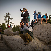 Photographers snap photos of Half Dome as it is lit up at sunset in this view from Glacier Point inside Yosemite National Park on Sunday, September 22, 2019 in Yosemite, California. (Alex Menendez via AP)