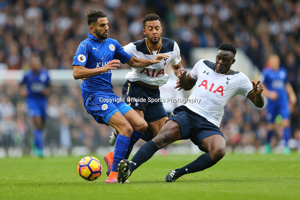 29 October 2016 - Premier League - Tottenham Hotspur v Leicester City - Riyad Mahrez of Leicester City tangles with Mousa Dembele and Victor Wanyama of Tottenham Hotspur - Photo: Marc Atkins / Offside.