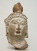 Head of a Bodhisattva. Chinese Tang dynasty (618–907) Date 710. Sandstone with pigment
