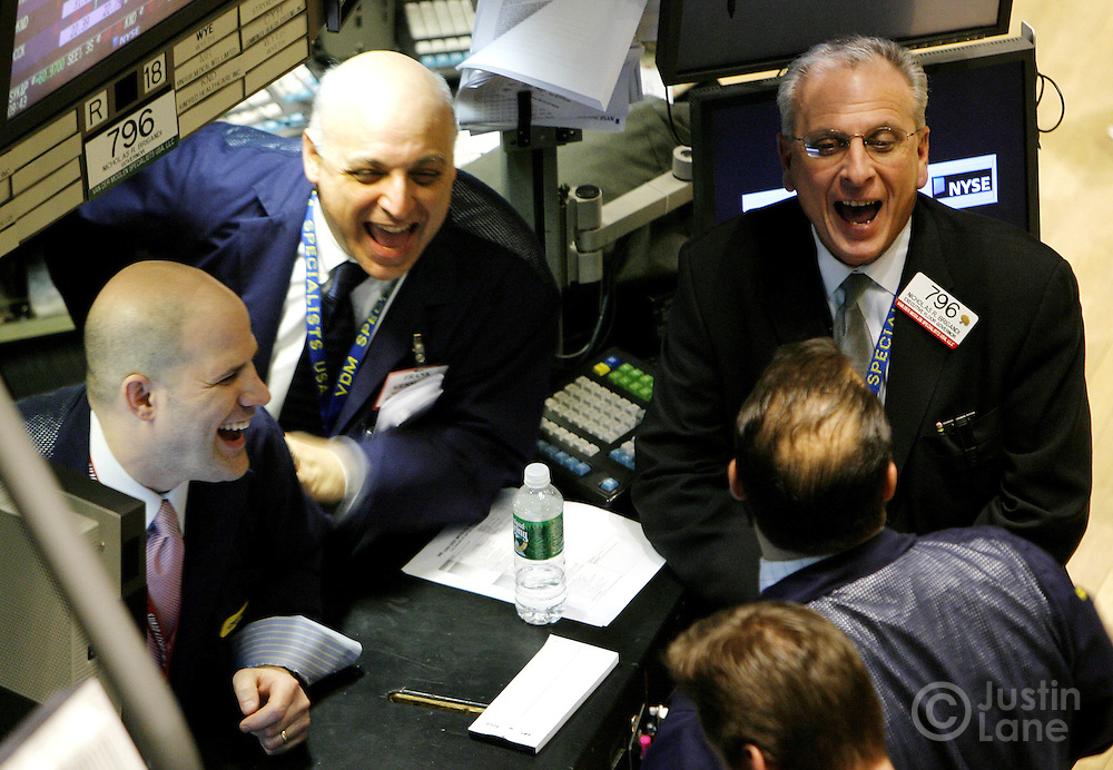 Traders joke around  on the floor of the New York Stock Exchange at the start of trading in New York, New York on Wednesday 28 February 2007. The Dow Jones Industrial average ended down 416 points yesterday, but stocks showed some signs of rebounding on Wednesday.