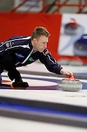 Mark Kennedy, second on Kevin Martin'steam throws his rock in the team's first draw Wednesday.  The 2011 GP Car and Home Players' Championship ran April 12-17 at the Crystal Centre, Grande Prairie, AB..11-04-13, Photo Randy Vanderveen, Grande Prairie, Alberta.