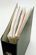 Business folder with papers