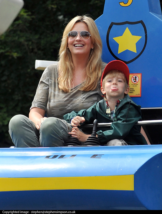 © licensed to London News Pictures. WINDSOR, UK.  09/07/11. Penny Lancaster and her son Alastair on the Chopper Squadron ride at Legoland Windsor, today 09 July 2011. Penny Lancaster is married to Rod Stewart.  PERMISSION GRANTED BY PENNY LANCASTER FOR CHILDREN TO BE IDENTIFIED. Mandatory Credit Stephen Simpson/LNP