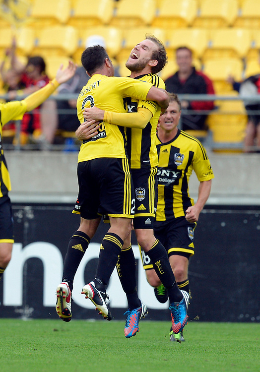 Phoenix's Jeremy Brockie, right, celebrates with Manny Muscat after scoring against the Melbourne Victory FC in the A-League football match at Westpac Stadium, Wellington, New Zealand, Sunday, March 31, 2013. Credit:SNPA / Ross Setford