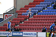 The Wigan mascot sits in the stands on his own to watch the game. Skybet football league championship match , Wigan Athletic v Leeds Utd at the DW Stadium in Wigan, Lancs on Saturday 7th March 2014.<br /> pic by Chris Stading, Andrew Orchard sports photography.