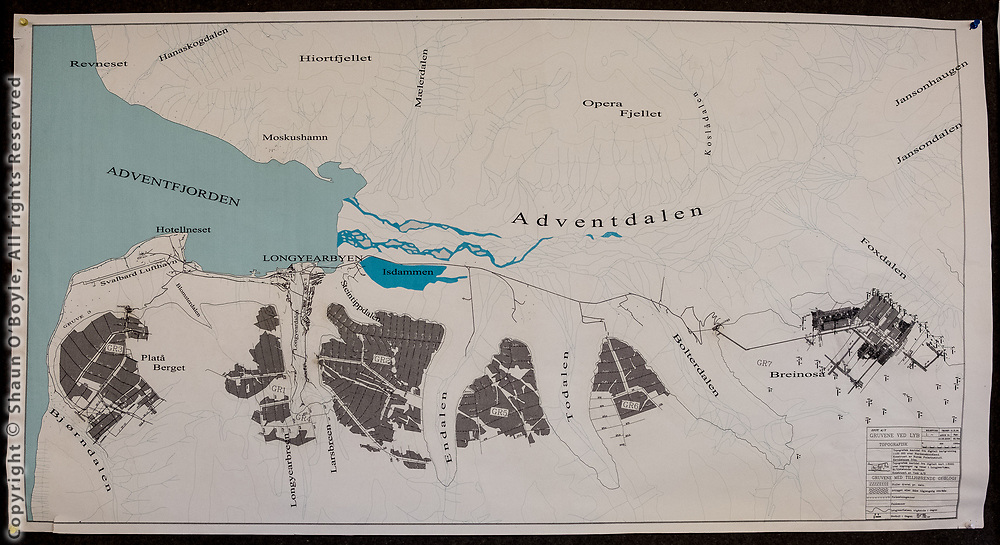 Map of Longyearbyen region, gray areas are cross sections of mountains showing the extent of the coal mining tunnels. Each mine has a network of mine shafts covering the footprint of the mountain, with multiple exits to fresh air.