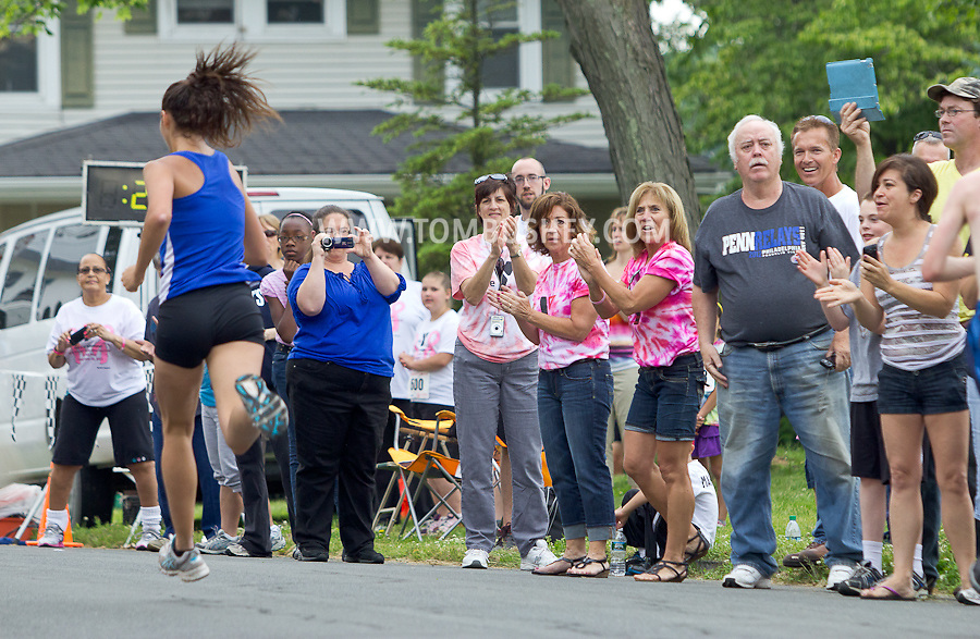 Middletown, New York - Spectators cheer for runners at the finish line in the 16th annual Ruthie Dino-Marshall 5K Run/Walk put on by the Middletown YMCA on Sunday, June 10, 2012. ©Tom Bushey / The Image Works
