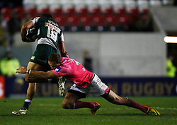 Peter Betham (L) is tackled by Herman Meyer Bosman on Stade Francais - Mandatory byline: Jack Phillips / JMP - 07966386802 - 13/11/15 - RUGBY - Welford Road, Leicester, Leicestershire - Leicester Tigers v Stade Francais - European Rugby Champions Cup Pool 4