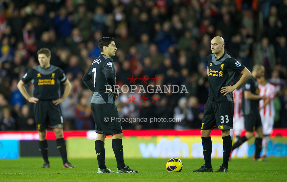 STOKE-ON-TRENT, ENGLAND - Boxing Day Wednesday, December 26, 2012: Liverpool's Luis Alberto Suarez Diaz and Jonjo Shelvey look dejected as Stoke City score the third goal during the Premiership match at the Britannia Stadium. (Pic by David Rawcliffe/Propaganda)