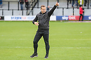 Forest Green Rovers manager, Mark Cooper salutes the travelling fans at the end of the match during the EFL Sky Bet League 2 match between Salford City and Forest Green Rovers at Moor Lane, Salford, United Kingdom on 28 September 2019.