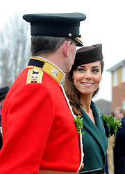 HRH The Duchess of Cambridge presents shamrocks to members of 1 Irish Guards at Mons Barracks in Aldershot today (17 Mar 2012) to mark the occastion of St Patricks Day. ..During the ceremony HRH was presented a shamrock by the QM Majoy John Mateer which then precluded a parade and a posy presentation by daughter of Drill Sergeant Stevenson, Isabella (5)..NOTE TO DESKS: .MoD release authorised handout images. .All images remain crown copyright. .Photo credit to read - Sergeant Alison Baskerville RLC