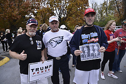 Trump supporters pose with Jonathan-Lee Riches, of West chester outside a rally with Melania trump, in Berwyn, PA, on Thursday.