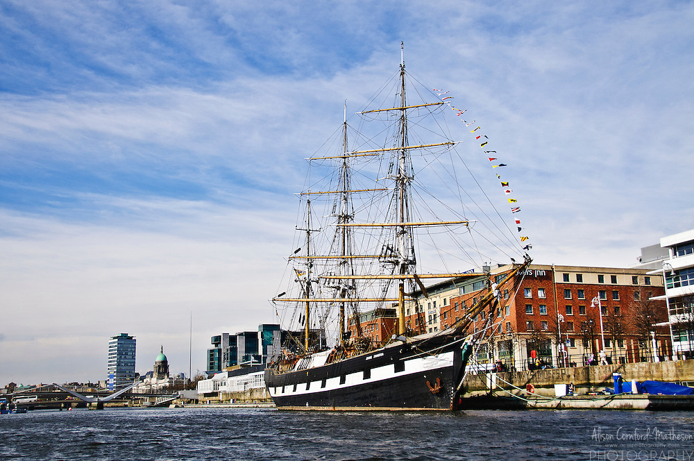 "The Jeanie Johnston is a replica ""famine ship"" docked at Custom House Quay on the Liffey River in Dublin, Ireland."