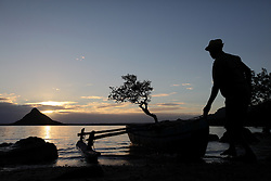 MADAGASCAR ANTSIRANANA 14MAY13 - Artisanal fishermen get ready to go fishing in their pirgoues, small wooden outrigger boats from the beach at Baie Andovobazaha near Antsiranana, Madagascar.<br /> <br /> <br /> <br /> jre/Photo by Jiri Rezac / Greenpeace
