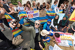 © Licensed to London News Pictures. 25/08/2016. Woman wearing a BINKINI amongst demonstrators hold a protest outside the French embassy against the banning of BURKINI swim wear on beaches in France.  The controversial ban cites religious clothing in the wake of recent terrorist killing in the country. London, UK. Photo credit: Ray Tang/LNP