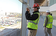 Linn County Supervisor Brent Oleson takes a picture of downtown during a tour of the new Federal Courthouse in Cedar Rapids on Tuesday morning, April 10, 2012. (Stephen Mally/Freelance)