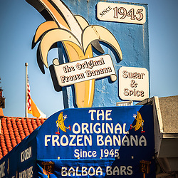Picture of Sugar and Spice Frozen Banana sign on Balboa Island in Newport Beach California. Sugar n' Spice is a dessert shop serving the Orginal Frozen Banana and Balboa Bars since 1945 in Orange County California.