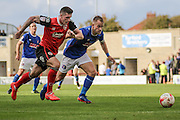 Morecambe Defender James Jennings and Carlisle united Danny Grainger battle during the EFL Sky Bet League 2 match between Morecambe and Carlisle United at the Globe Arena, Morecambe, England on 8 October 2016. Photo by Pete Burns.