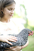 Sarah Rackley and her Barred Rock hen, Rosie. Rackley has the first legal chickens in Durham.