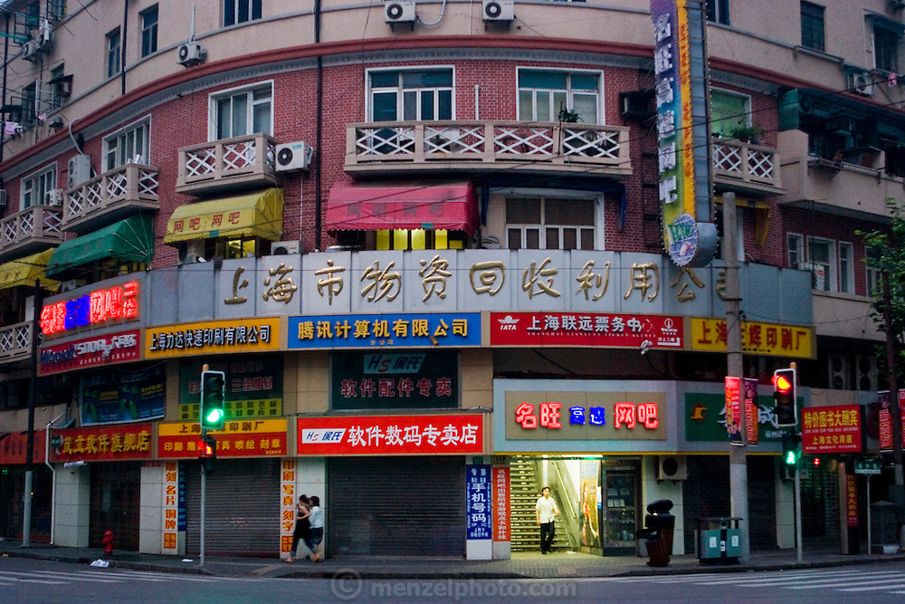 Ming Wang Internet cafe in Shanghai, China, where extreme gamer Xu Zhipeng rents a chair for six months and continuously plays games. His longest continuous game lasted three days and nights. China has more than 300 million Internet users; a number close to the entire population of the United States. (Xu Zhipeng is featured in the book What I Eat: Around the World in 80 Diets).
