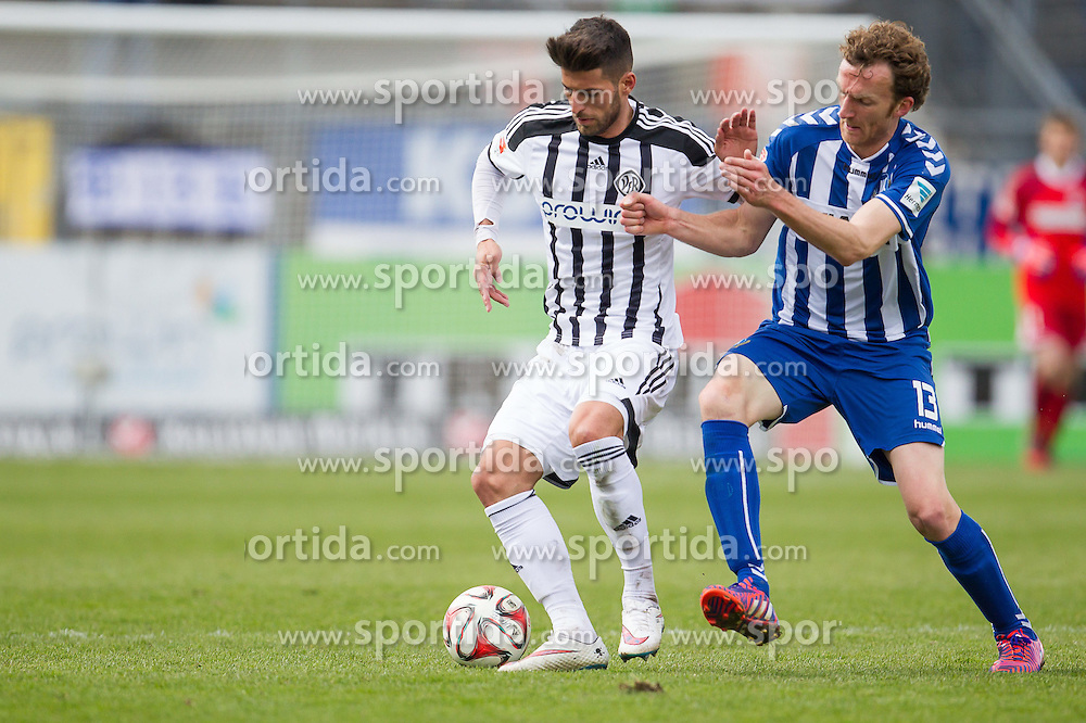 05.04.2015, Scholz Arena, Aalen, GER, 2. FBL, VfR Aalen vs Karlsruher SC, 27. Runde, im Bild Juergen Gjasula ( VFR Aalen) im Zweikampf mit Dominic Peitz ( Karlsruher SC ) // during the 2nd German Bundesliga 27th round match between VfR Aalen and Karlsruher SC at the Scholz Arena in Aalen, Germany on 2015/04/05. EXPA Pictures &copy; 2015, PhotoCredit: EXPA/ Eibner-Pressefoto/ Bozler<br /> <br /> *****ATTENTION - OUT of GER*****