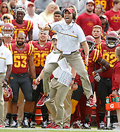 Iowa State head coach Matt Campbell leaps in the air as he yells to his defenders from the sideline as Baylor pushes their way down field Saturday, Oct. 1, 2016 at at Jack Trice Stadium in Ames.